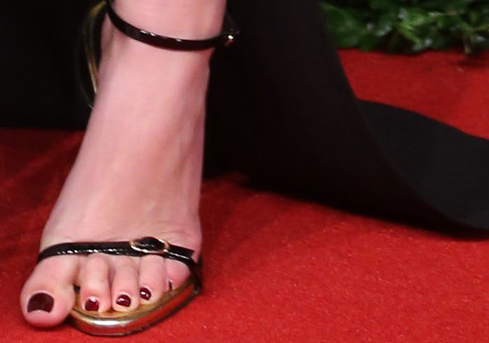 Mollie King shows off her pedicure with a toe hanging over her sandal
