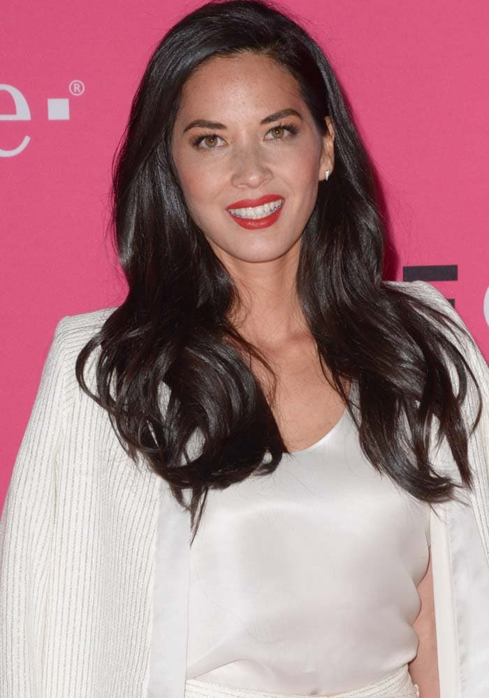 Olivia Munn wears her dark hair down at the T-Mobile Uncarrier X launch