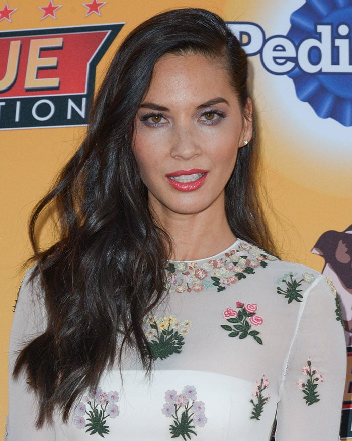 Olivia Munn wears her hair down at the All Star Dog Rescue Celebration