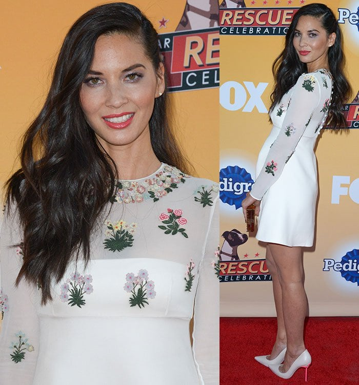 Olivia Munn wears coral lipstick and white pumps on the red carpet