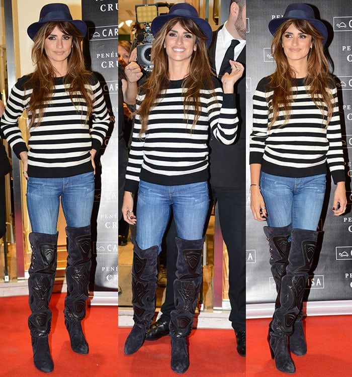 Penelope Cruz wears a Eugenia Kim fedora hat with a striped shirt on the red carpet