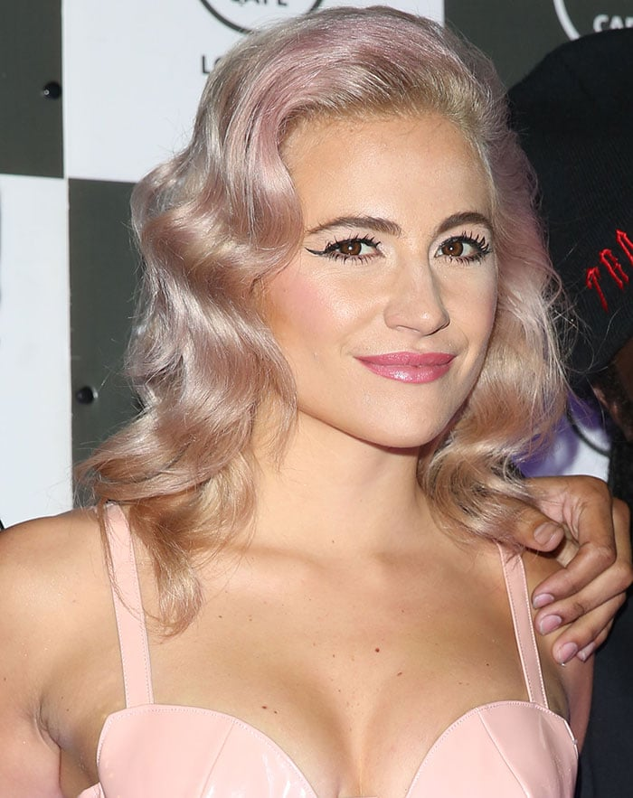 Pixie Lott wears her pink hair down at Hard Rock Cafe in London