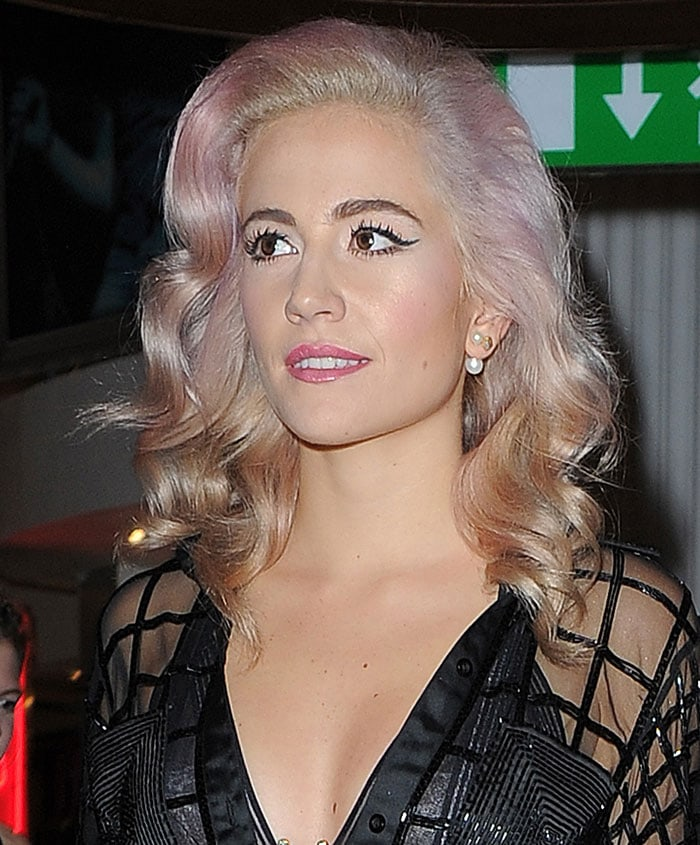 Pixie Lott changes into a new outfit for her performance at Hard Rock Cafe London