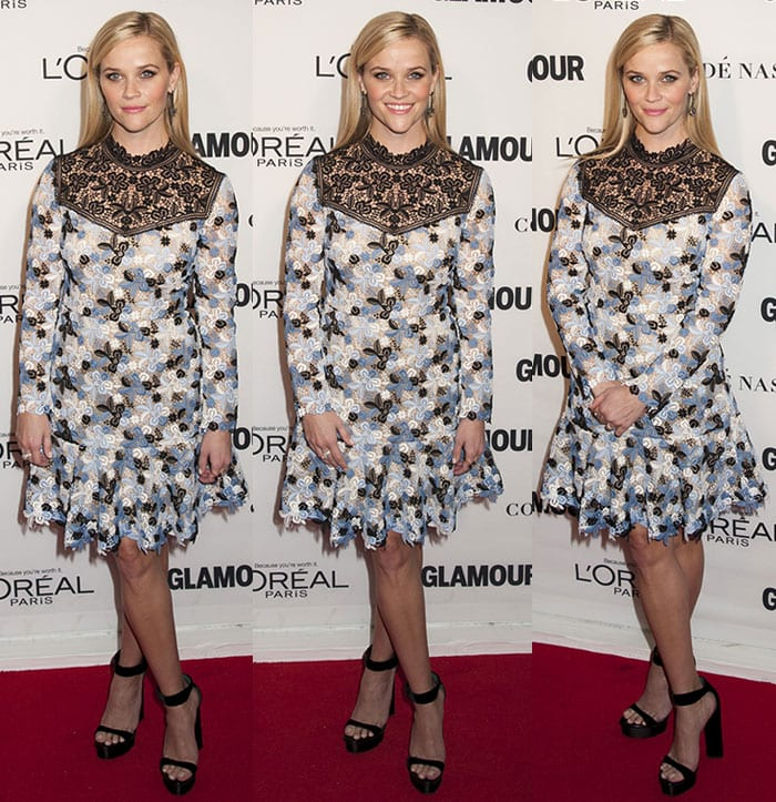 Reese Witherspoon poses on the red carpet in a feminine Erdem dress
