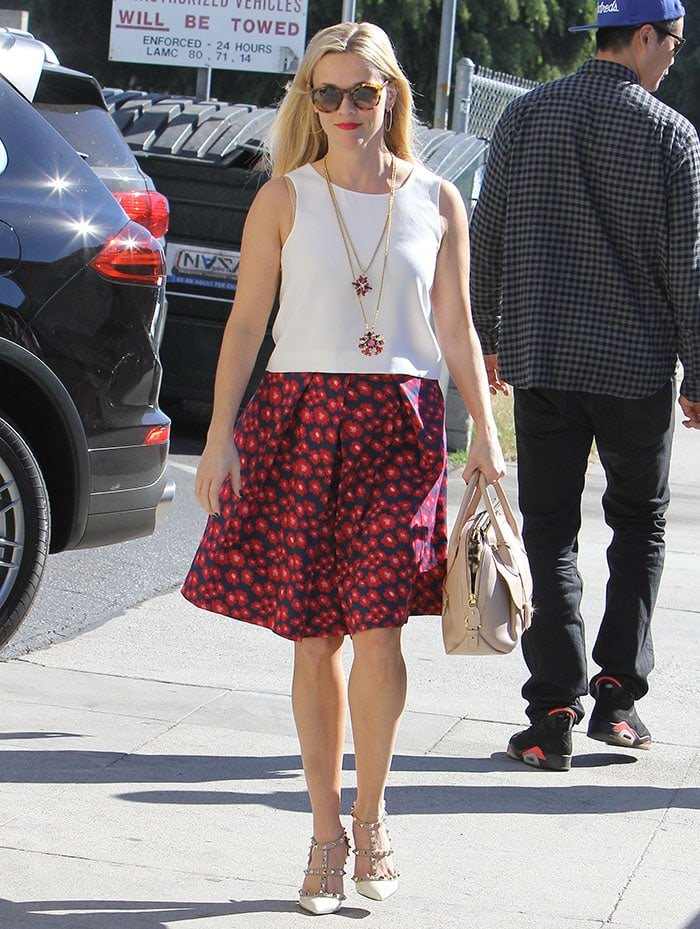 Reese Witherspoon wears her blonde hair down for a shopping trip and a business meeting