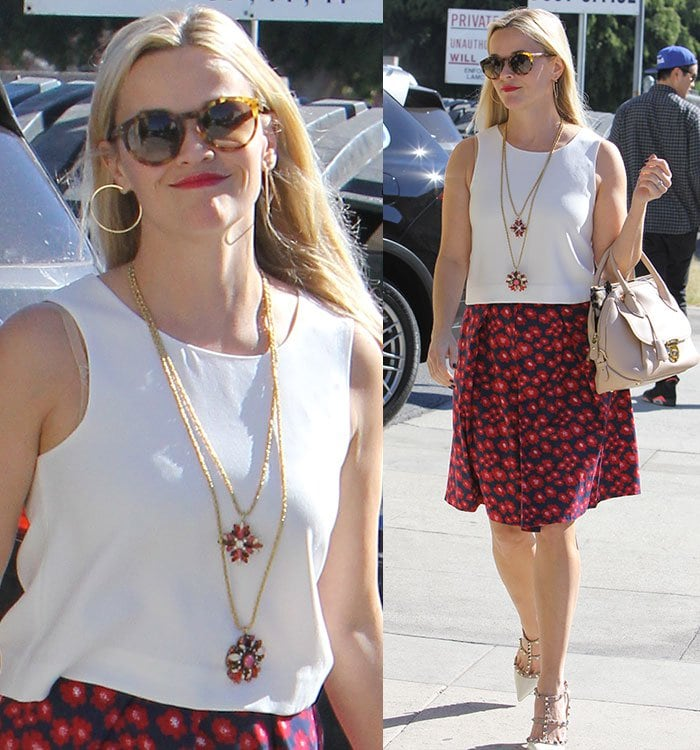 Reese-Witherspoon-white-sleeveless-top-red-blue-floral-skirt