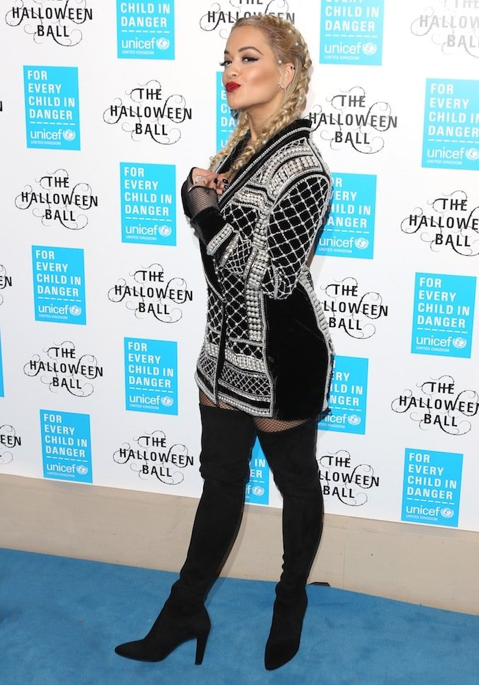 Rita Ora in a Balman x H&M blazer paired with thigh-high boots for Unicef UK's Halloween Ball on October 29, 2015 at One Mayfair in London
