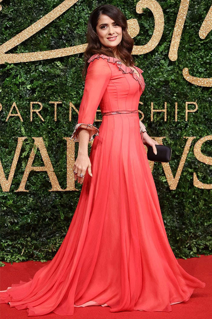 Salma Hayek's red Gucci gown with trompe l'oeil ruffle collar, waist ribbon, and ruffle cuffs in full length