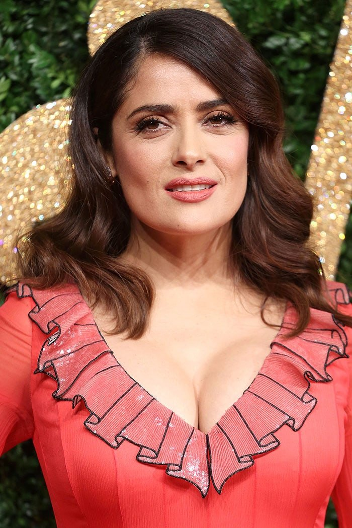 Salma Hayek once again showing off major cleavage