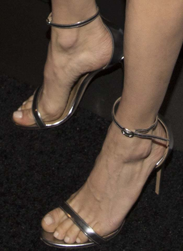 Sienna Miller's feet in silver Bally heels