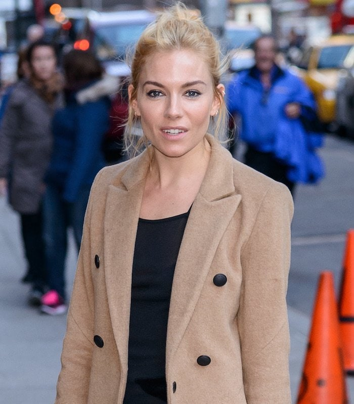 "Sienna Miller wears her blonde hair in a messy bun for an appearance on ""Late Night with Stephen Colbert"""