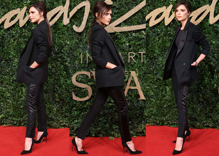 Victoria Beckham wears a blazer-and-pants combination from her own line