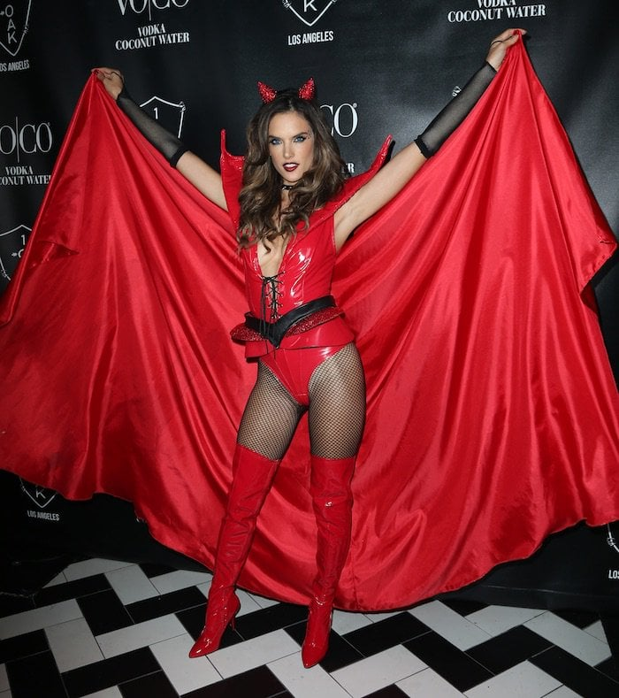 Alessandra Ambrosio dresses as a sexy, red devil temptress to host a Heaven and Hell-themed Halloween party