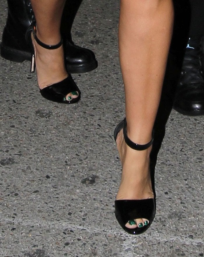 Amber Rose shows off her feet in high heels