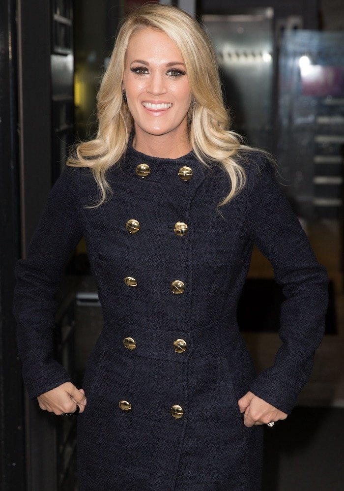 """Carrie Underwood wears her blonde hair down as she leaves BBC Radio 2 studios after an interview on """"The Chris Evans Breakfast Show"""""""