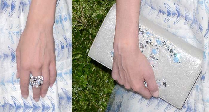 Diane Kruger holds a Chanel clutch