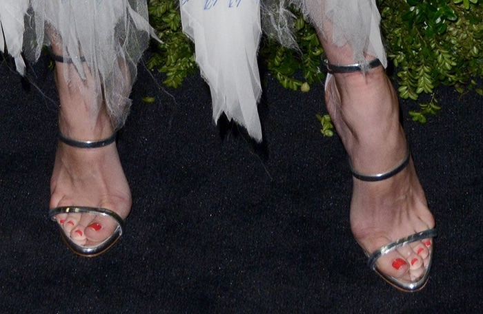 Diane Kruger displays her sexy toes in metallic strappy sandals