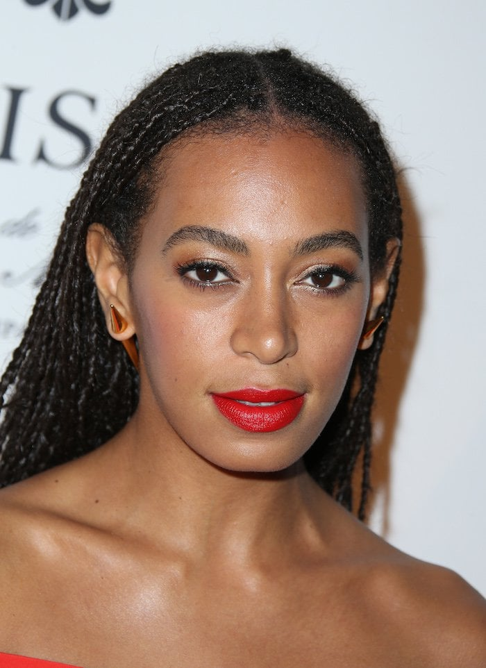 We also love her waist-length braids and bold red lips