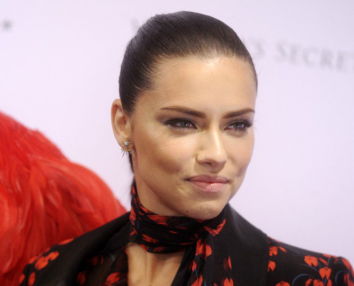 Adriana Lima wears her hair slicked back at the Madame Tussauds wax replica unveiling
