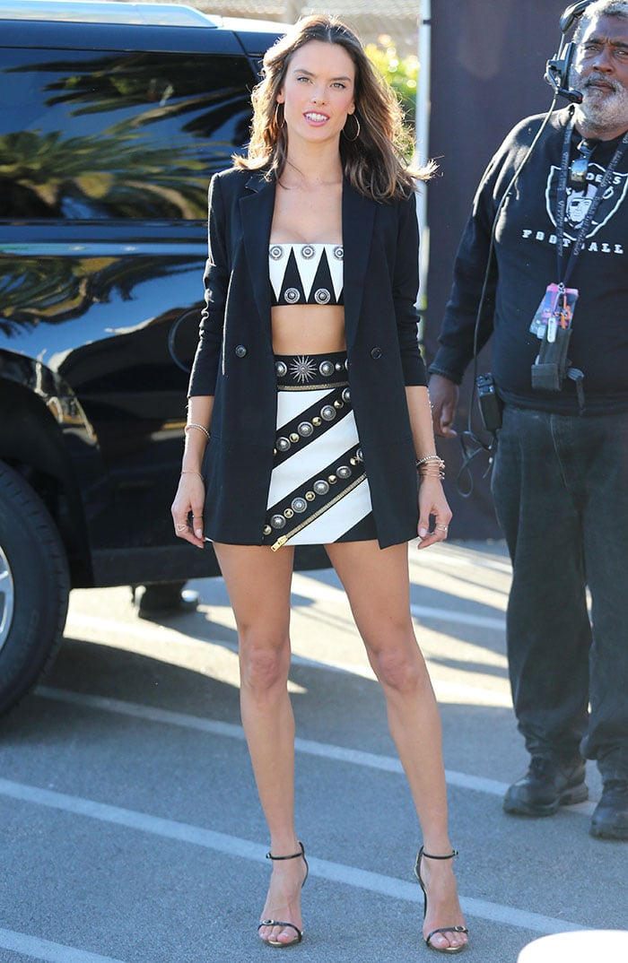 Alessandra Ambrosio flaunts her abs and legs in a Fausto Puglisi ensemble
