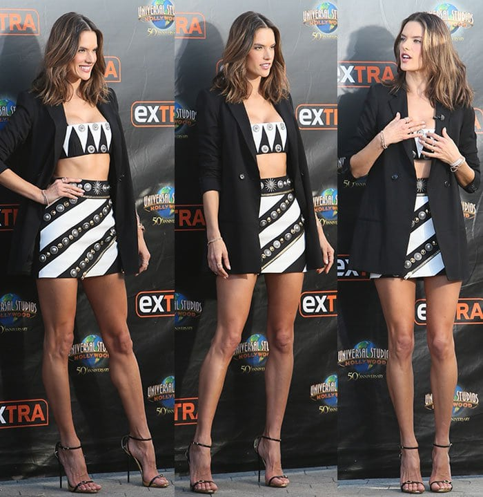 Alessandra Ambrosio shows off her model figure in a Fausto Puglisi ensemble topped with a black blazer