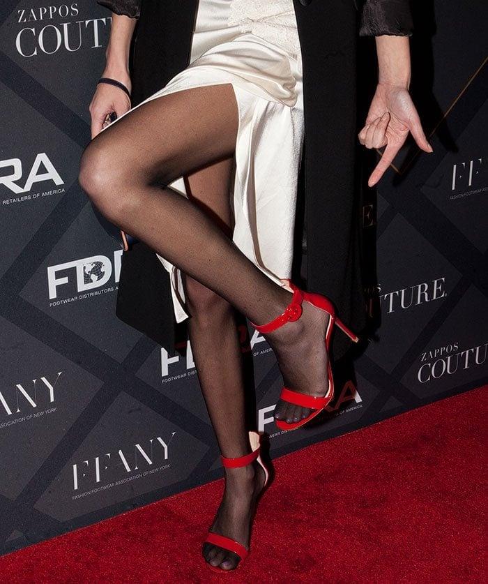 Alexa Chung's feet in Gianvito Rossi heels and black stockings