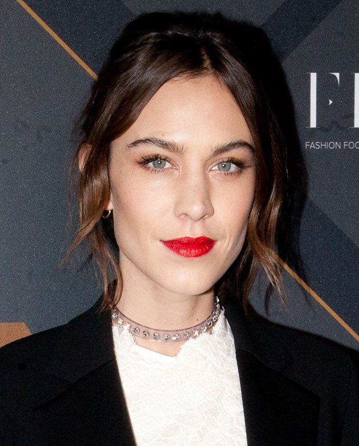 Alexa Chung wears her hair back at the Footwear News Achievement Awards