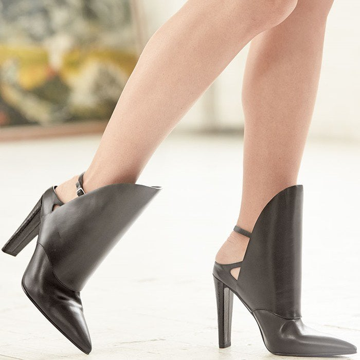 Finished with a sturdy ostrich-effect heel, this backless ankle boot looks best with shorter hemlines