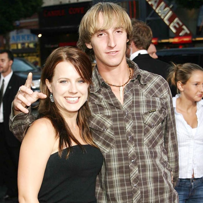 """Actress Allison Munn and her brother Russell Clark Munn Jr. at the premiere of Warner Bros. """"Exorcist: The Beginning"""""""