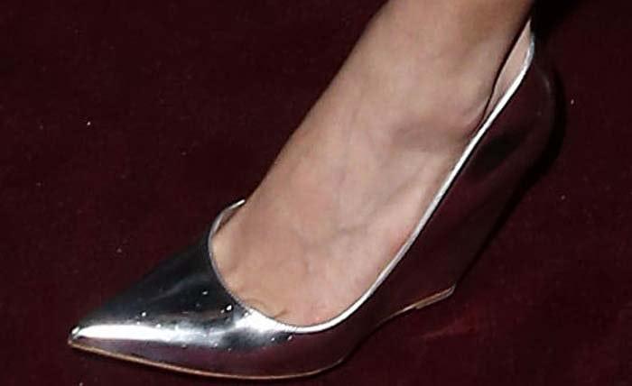 Amal Clooney shows off her feet inchic metallic wedge by Nicholas Kirkwood