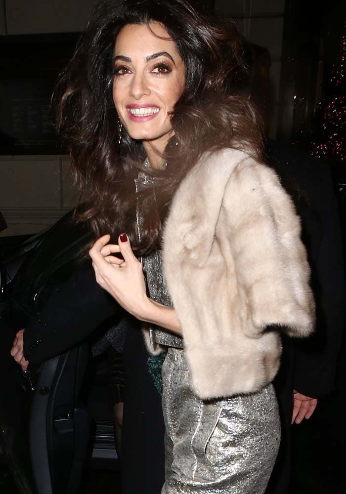 Amal Clooney wore her trademark brown-eyeshadow-and-pink-lip makeup with a hairstyle that was slightly more tousled than her usual
