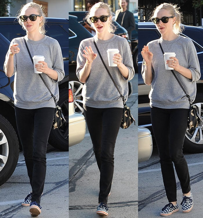 Amanda Seyfried wears a gray sweatshirt and Ksubi black jeans while leaving breakfast