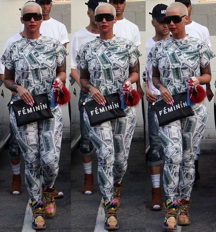 Amber Rose wears a $100 bill-printed jumpsuit while out in Beverly Hills