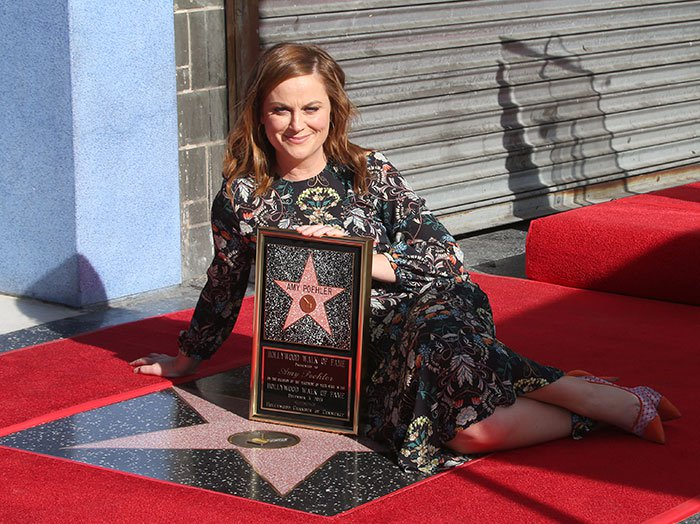 Amy Poehler poses with her new star on the Los Angeles Hollywood Walk of Fame