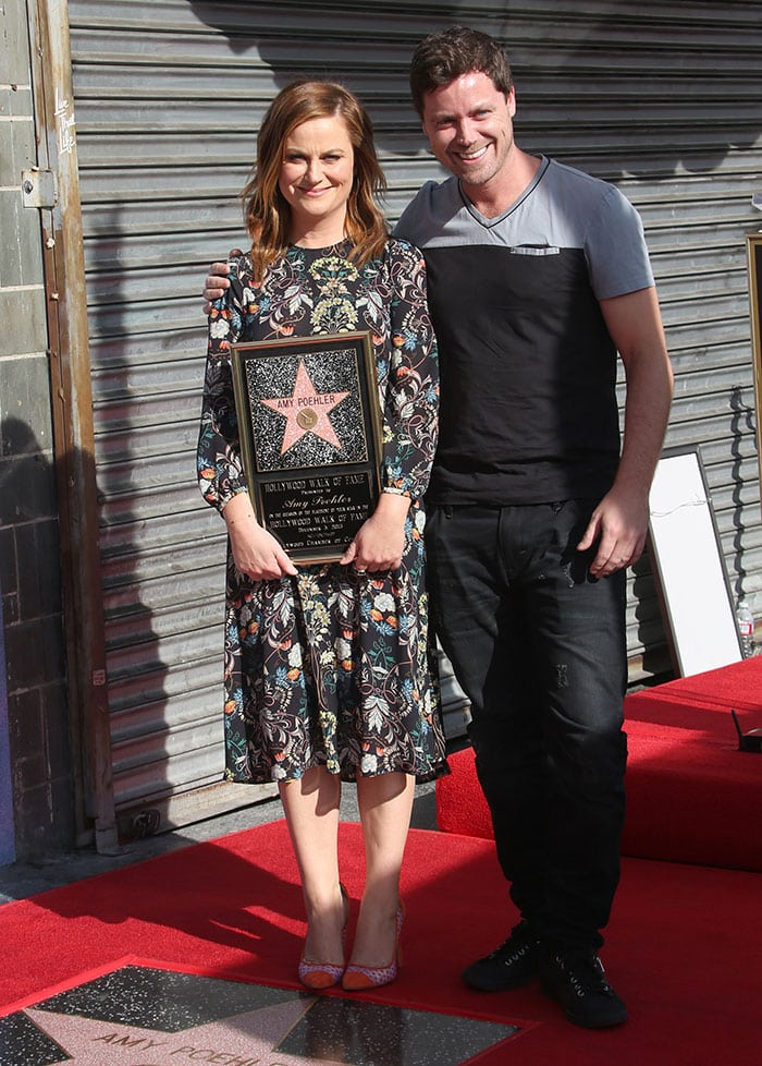 Amy Poehler poses with her brother Greg on the Los Angeles Hollywood Walk of Fame