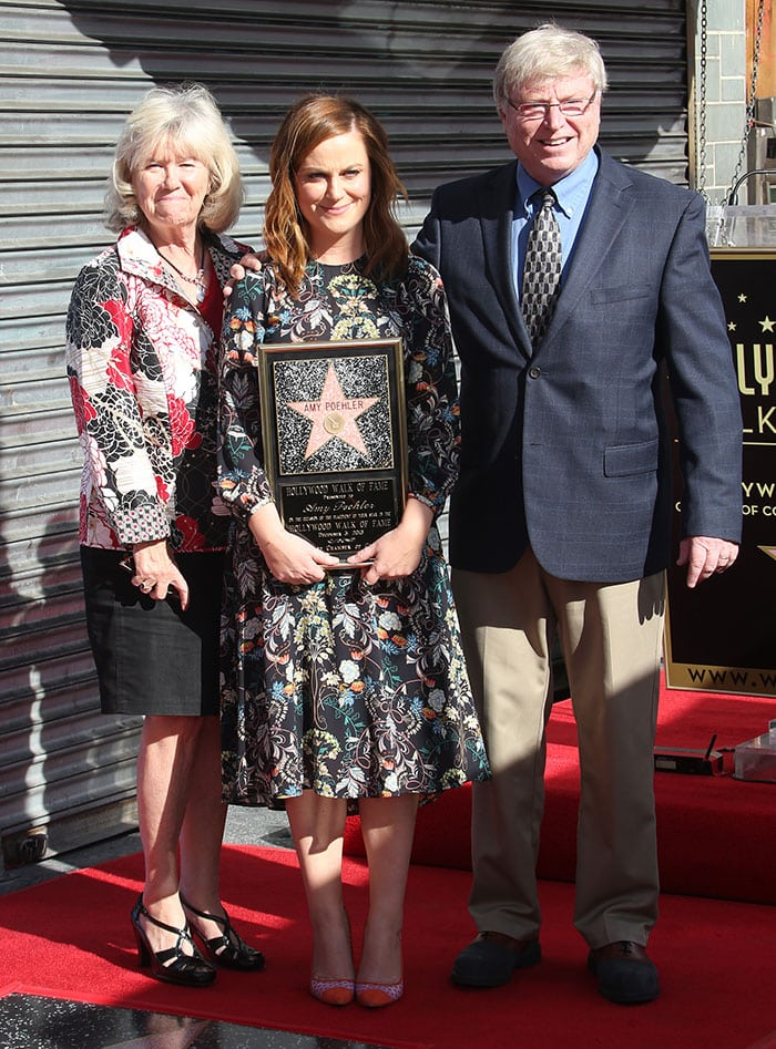 Amy Poehler poses with her parents, Eileen and William Poehler, as she receives her star on the Hollywood Walk of Fame