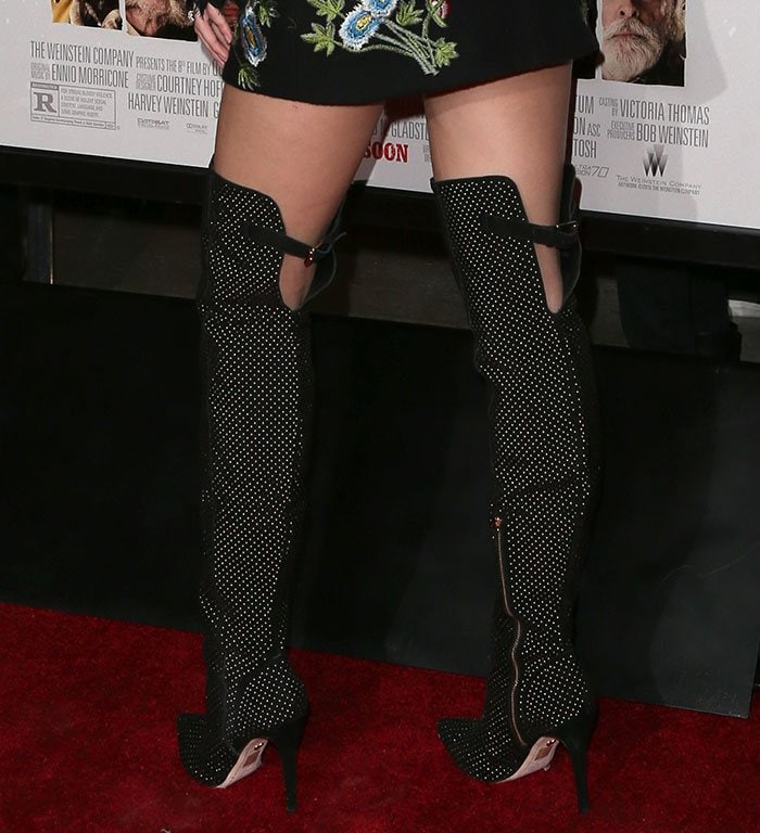 Bella Thorne's boots with gold-tone micro-studs