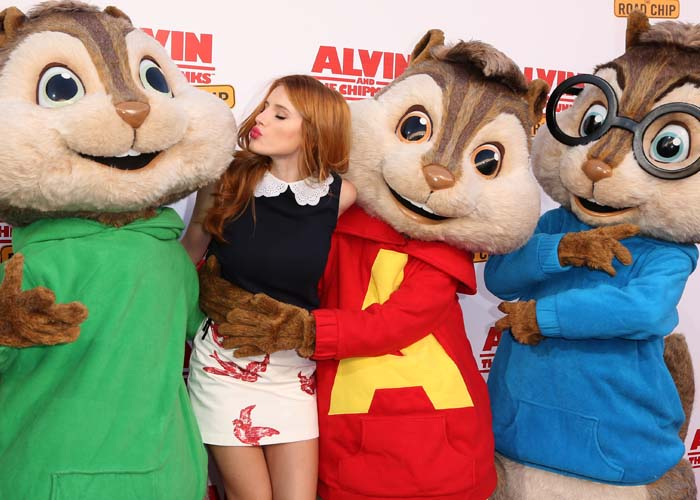 Bella Thorne poses with Alvin and the Chipmunks on the red carpet