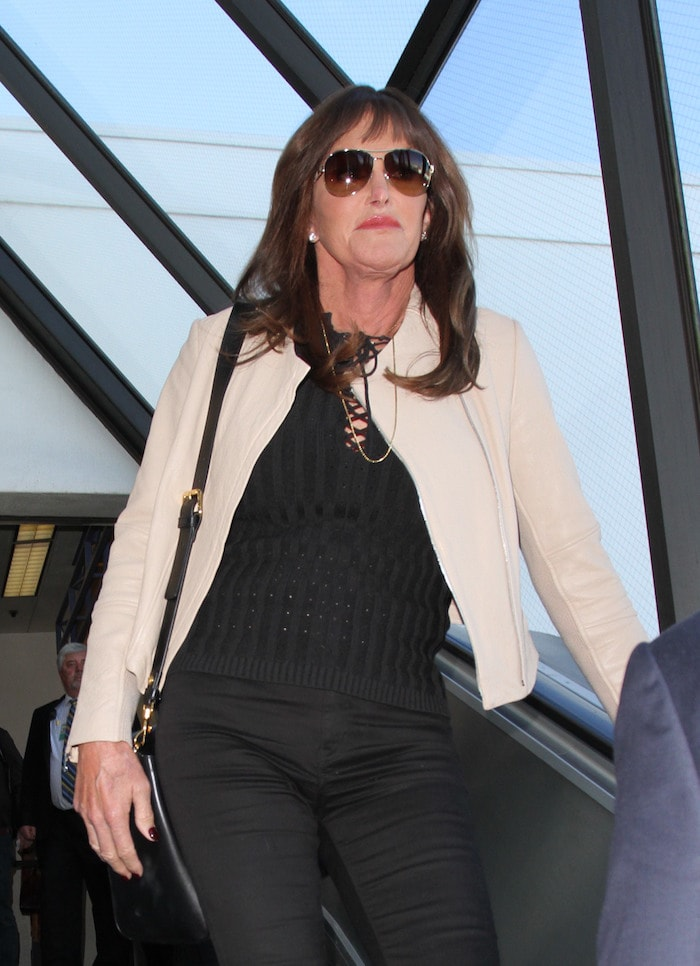 Caitlyn Jenner wears her hair down as she arrives at Los Angeles International Airport