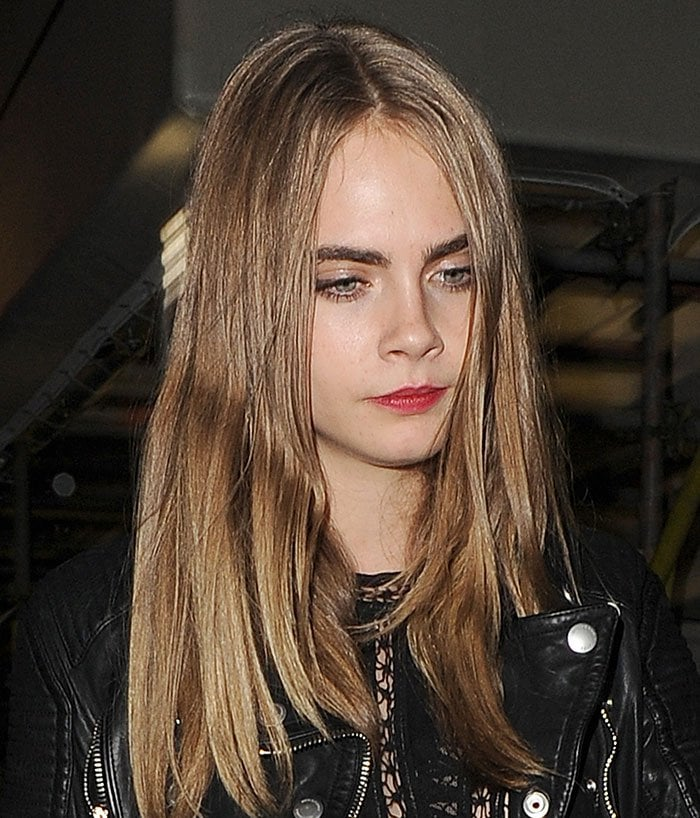 Cara Delevingne wears her hair down as she leaves Scala club in London