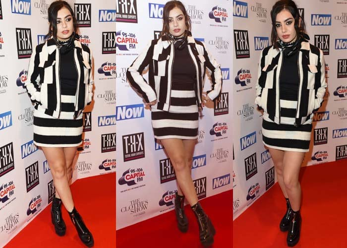 Charli XCX shows off her hot legs in a striped jacket and a matching skirt
