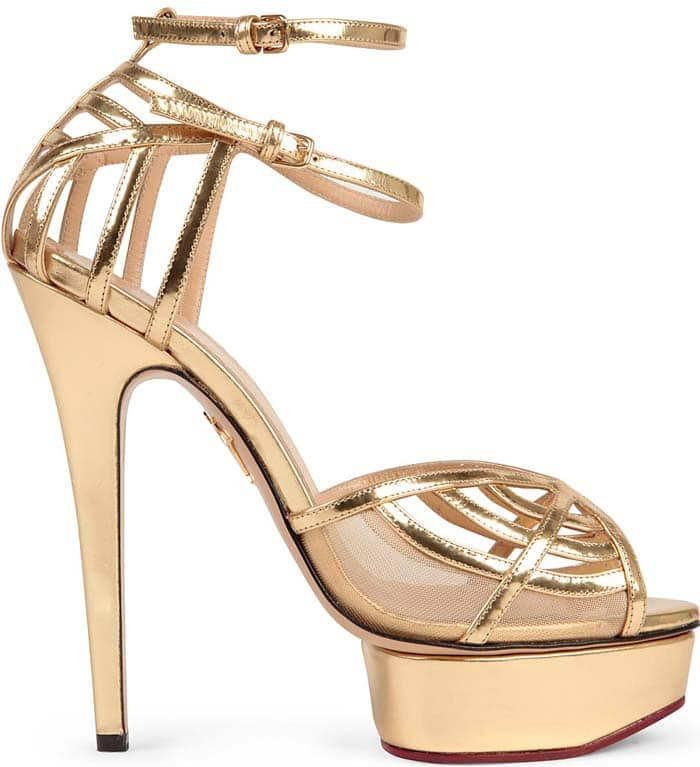 Charlotte Olympia spins her signature web in golden leather to make the Octavia ankle-strap sandal a high-shine icon