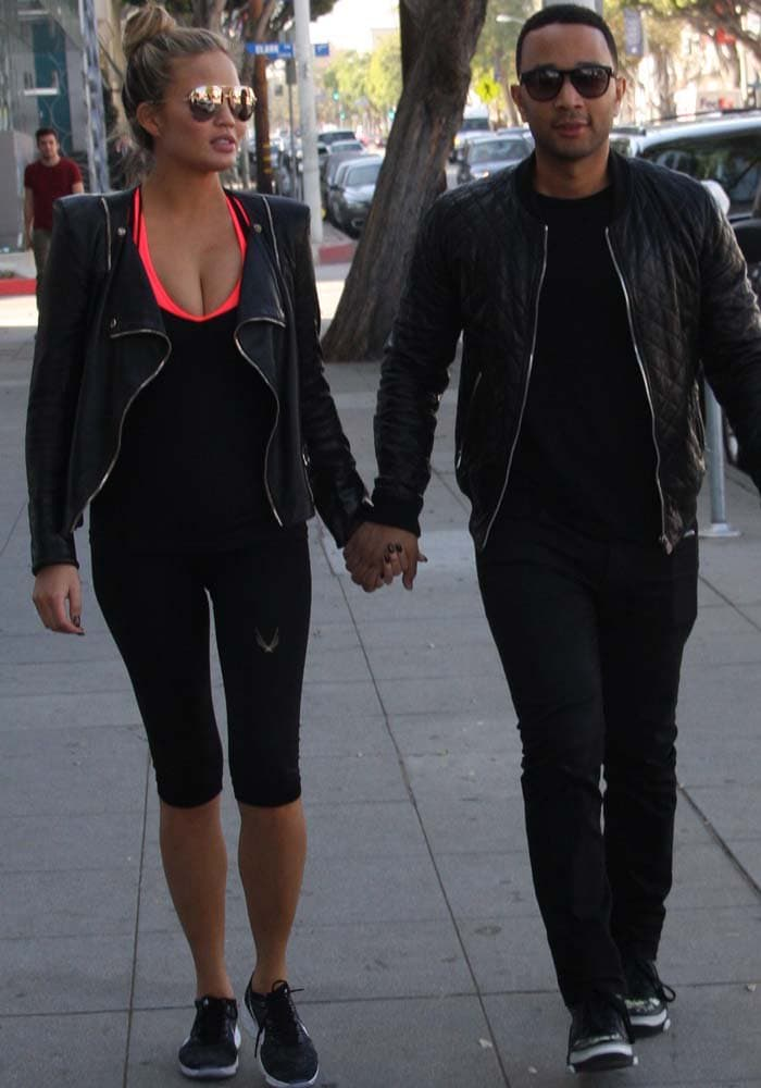 Chrissy Teigen and John Legend go for a walk in matching leather jackets