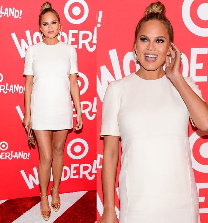 Chrissy Teigen shows off her gold earrings on the red carpet