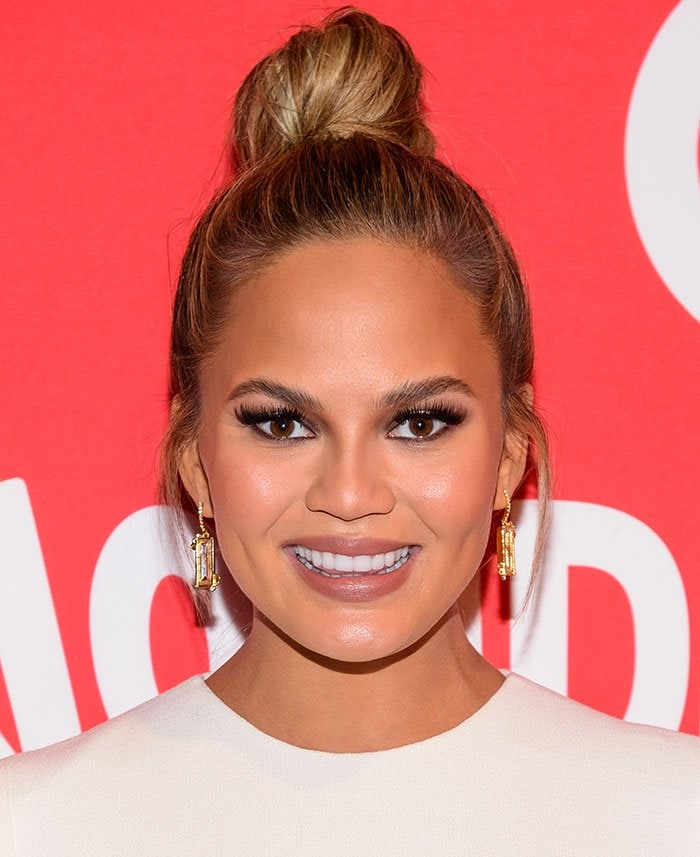 Chrissy Teigen wears her hair in a bun at the launch of Target Wonderland in the meatpacking district of New York City