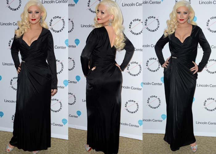 Christina Aguilera shows off her cleavage in a black Versace dress