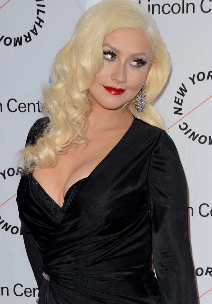Christina Aguilera goes old-Hollywood glam with soft blonde curls and bright red lipstick