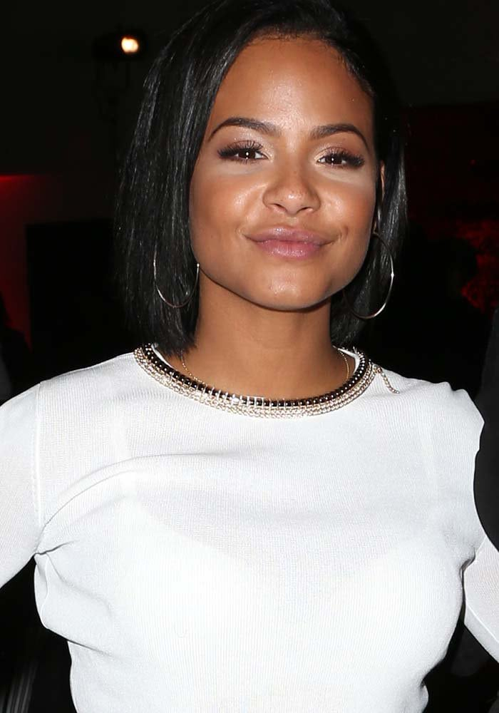 Christina Milian wears her hair down at the inaugural World AIDS Day Benefit presented by UnAIDS