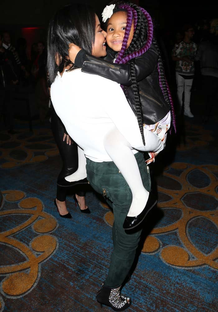 Christina Milian poses with her daughter Violet, who wore her black-and-purple hair in long twists