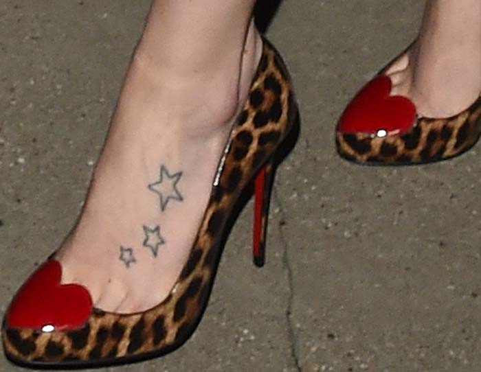 Daisy Ridley's feet and star tattoos in Christian Louboutin heart-and-leopard-print pumps